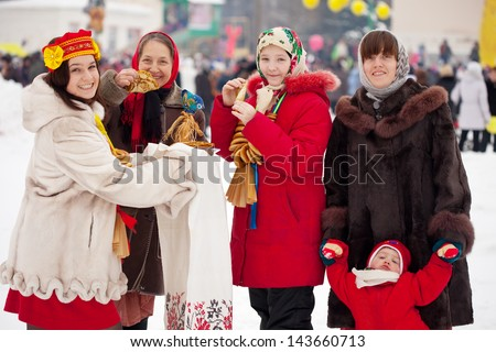 happy people with pancake celebrating  Maslenitsa festival  at Russia