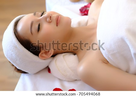 Happy relaxing asian girl at beauty spa treatment. Spa concept.