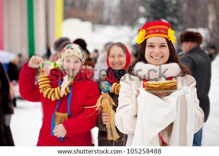 happy women with pancakes celebrating  Shrovetide  at Russia - stock photo