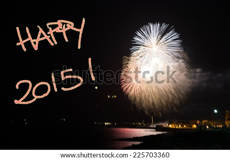 """""""happy 2015"""" written in the night with fireworks - stock photo"""