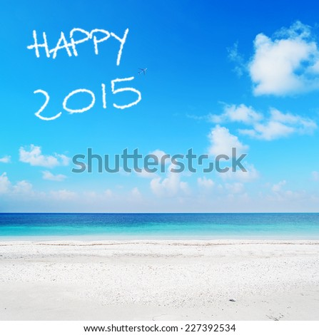 """happy 2015"" written in the sky over a turquoise shore - stock photo"