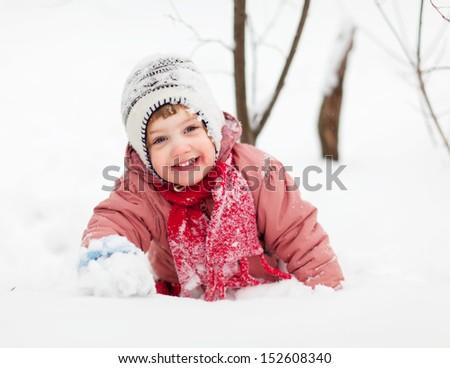 happy 2 years baby girl in winter park - stock photo