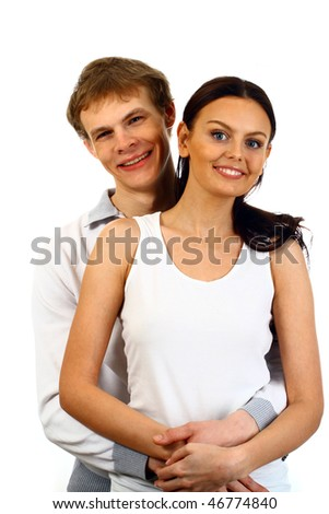 Happy young couple in casual clothing. Isolated. - stock photo