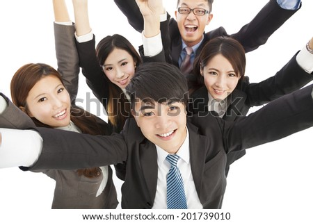 happy young success business team raise hands - stock photo