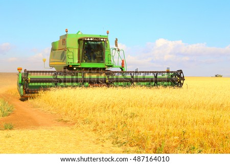 harvester gathers the wheat