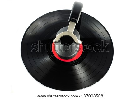 headphones and old  disc  - music concept - - stock photo