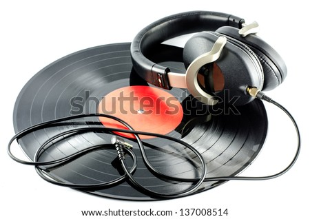 headphones on old  disc  - music concept - - stock photo