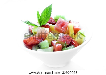healthy and deliciously looking bowl of fruit salad on white background - stock photo