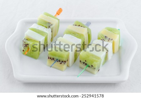 Healthy appetizer with fruits and cheese - stock photo