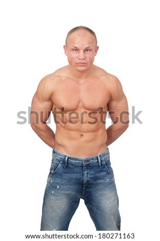 Healthy muscular young man posing in jeans isolated on white