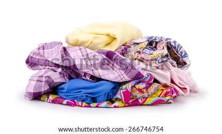 Heap of colorful clothes isolated on white background. - stock photo