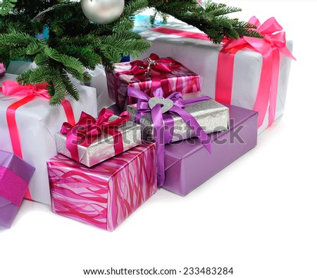 heap of  gifts under Christmas tree isolated on  white - stock photo