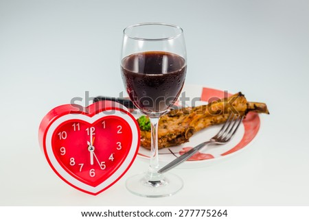 Heart Clock  with juicy grilled pork chop,Drink Wine for dinner time - stock photo