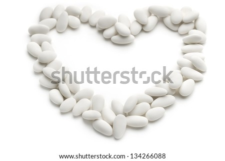 heart of sugared almonds on white background - stock photo