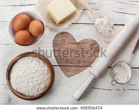 heart of the flour on the board rolling pin Eggs.