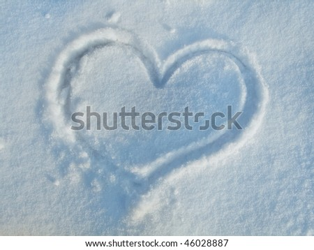 Heart on the snow - stock photo