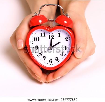 Heart shape alarm clock  - stock photo