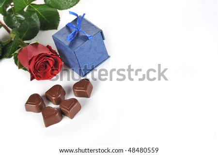 Heart shape chocolate, rose and  gifts in box close-up