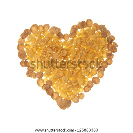heart shape made of corn flakes against white background - stock photo