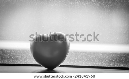 Heart-shaped black and white on window  old background. - stock photo