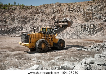 heavy building bulldozer quarry,car - stock photo