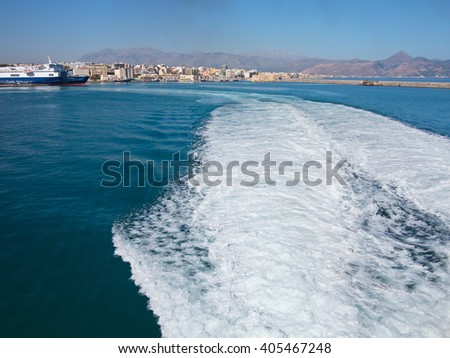 18.06.2015; Heraklion, Greece - View to seaport and trace of water from the outgoing ship. - stock photo