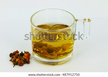 Herbal of tea Cordyceps Militaris or chong cao  and tea rose on gray background. drink for healthy.