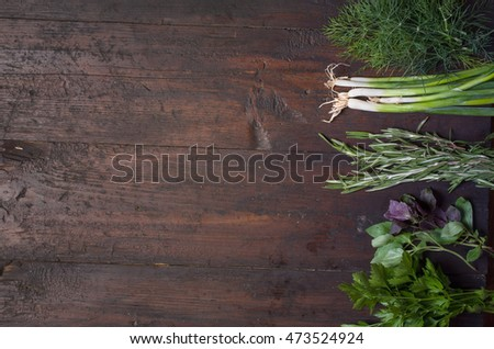 herbs on old wooden background