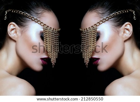 High fashion look.glamor closeup portrait of beautiful sexy Caucasian young woman model with colorful lips,bright makeup, with perfect clean skin with jewelery on eye isolated on black - stock photo