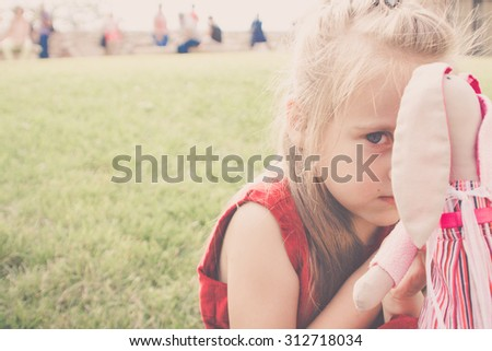 high key portrait of a lonely child - stock photo