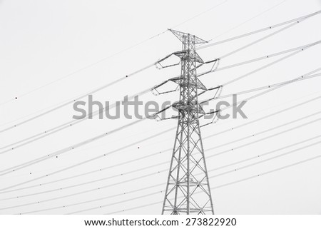 high voltage power lines and pylon - stock photo