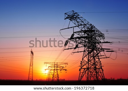High voltage power lines at sunset   - stock photo