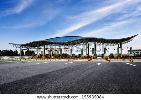 highway toll and vehicle - stock photo