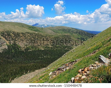 hiking in  james peak wilderness area, colorado, with long's peak in the background         - stock photo