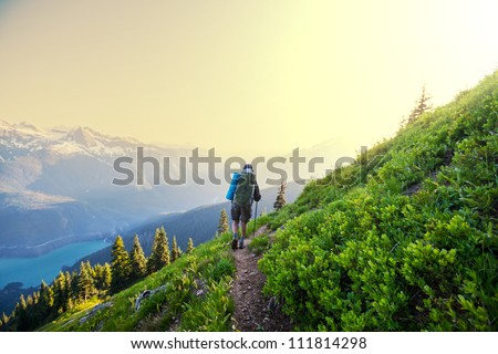 hiking in summer mountains - stock photo