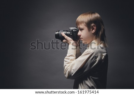 ?hild with camera - stock photo