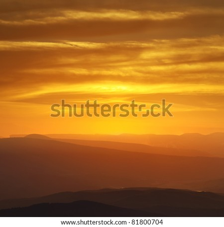 Hills and bright sky during sundown. Composition of the nature - stock photo