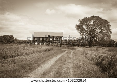 """""""Historic Home Sepia"""" A sepia toned look at the historic Molly Pitcher home in Monmouth Battlefield State Park in Monmouth County, New Jersey. - stock photo"""