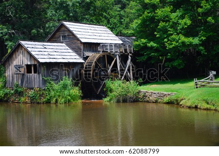 historical old water mill - stock photo