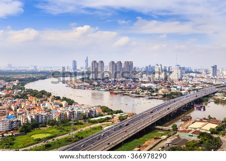 Hochiminh City, Vietnam - October 21, 2013: A view of panoramic Saigon Bridge on the SaiGonriver. This is a very important bridge,  from the HoChiMinh city leads to the north provinces of Vietnam. - stock photo