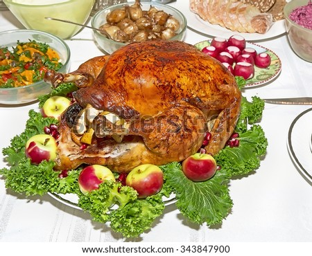Holiday table with roast stuffed capon on decorated plate - stock photo