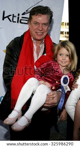 11/27/2005 - Hollywood - Christopher McDonald and daughter Eva attend the 2005 Hollywood Christmas Parade at the Hollywood Roosevelt Hotel in Hollywood, California, United States.   - stock photo