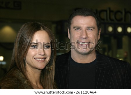 "02/14/2005 - Hollywood - John Travolta and Kelly Preston at the ""Be Cool"" Premiere Red Carpet at Grauman's Chinese Theater in Hollywood.  - stock photo"