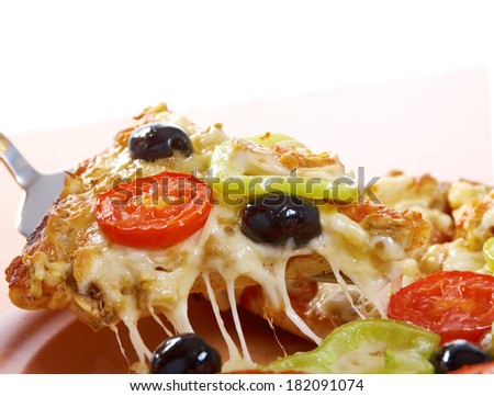.home pizza with tomato and eggplant  Closeup .taking slice of pizza,melted cheese dripping. isolated on white background.
