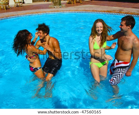 2 Honeymoon couples have a pool party! - stock photo