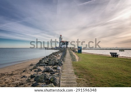 """Horse of Marken"" is a lighthouse on the Dutch peninsula Marken, on the IJsselmeer. - stock photo"