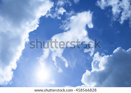 horse shape-like cloudy on bright blue sky metaphor as power  - stock photo