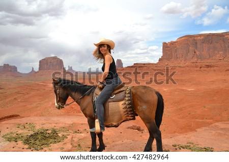 Horseback Riding at Monument Valley in Arizona,USA - stock photo