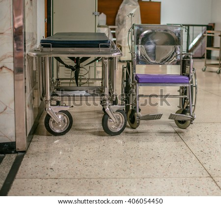hospital bed and Wheel Chair, paraplegia, handicapped parking in hospital - stock photo