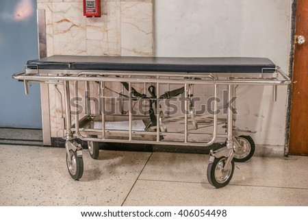 hospital bed on Waiting area , in front of lift - stock photo
